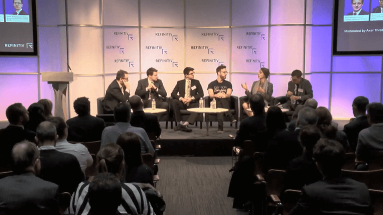 6 panelists sitting on a stage to discuss about the rise of digital finance and crypto assets